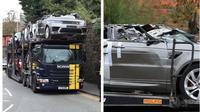 Truk trailer penganggkut mobil Range Rover tersangkut di kolong jembatan kereta api di Perth, Skotlandia. (@phil Hannah)