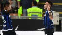Lautaro Martinez mencetak gol Inter Milan saat bertanding melawan Cagliari (29/9/2018). (AFP/Miguel Medina)