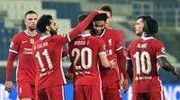 Pemain Liverpool merayakan gol yang dicetak Diogo Jota ke gawang Atalanta pada laga lanjutan Liga Champions 2020/2021 di Gewiss Stadium, Rabu (4/11/2020) dini hari WIB. Liverpool menang 5-0 atas Atalanta. (AFP/Miguel Medina)