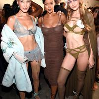Bella Hadid, Rihanna, and Gigi Hadid at Savage x Fenty NYFW Show (Photo via US Magazine)