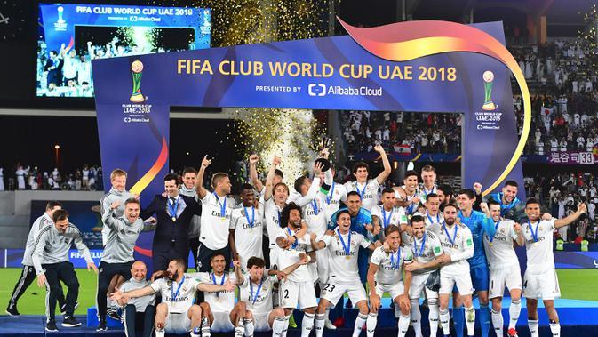 Real Madrid merayakan keberhasilan menjadi juara Piala Dunia Antarklub 2018. (AFP/Giuseppe Cacace)