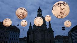 Balon yang menggambarkan wajah pemimpin negara anggota G7 menghiasi kota Dresden, Jerman, (27/5/2015). Kanselir Jerman Angela Merkel mengatakan, tak terbayangkan bila Rusia berpartisipasi dalam pertemuan G7. (REUTERS/Fabrizio Bensch)