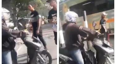 Aksi Pria Hentikan Pengendara Motor Terobos Rel Kereta Ini Bikin Salut
