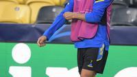 Penyerang Manchester United, Christiano Ronaldo mengambil bagian dalam sesi latihan di Bern (13/9/2021). Manchester United akan bertanding melawan Young Boys pada Grup F Liga Champions di Stadion Wankdorf. (AFP/Sebastien Bozon)