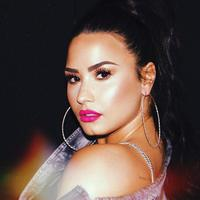 Demi Lovato memamerkan tato barunya lewat sosial media yakni Instagram. (instagram/ddlovato)