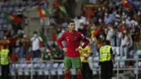 Bintang Portugal Cristiano Ronaldo bereaksi setelah pertandingan melawan Republik Irlandia pada babak kualifikasi Grup A Piala Dunia 2022 di Stadion Algarve, Kamis (2/9/2021) dini hari WIB. (CARLOS COSTA / AFP)