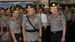 Kapolri Jenderal Pol Tito Karnavian, Wakapolri Komjen Pol Syafruddin dan Kepala Badan Intelijen Negara Jenderal Pol Budi Gunawan (kiri ke kanan) usai pelantikan jabatan Wakapolri di Mabes Polri, Jakarta, Sabtu (10/9). (Liputan6.com/Helmi Fithriansyah)