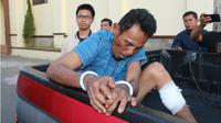 Aidil Ginting (40), pelaku pembunuhan istri dan anak tiri di Aceh. (Liputan6.com/Rino Abonita)