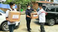 Wuling Motors dan Kumala Group menyalurkan bantuan untuk masyarakat yang terdampak bencana alam di Majene-Mamuju, Sulawesi Barat. (Wuling)