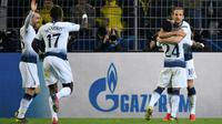 Tottenham Hotspur meraih tiket ke perempat final Liga Champions, setelah meraih kemenangan agregat 4-0 atas Borussia Dortmund. Dalam laga leg kedua 16 besar di Signal Iduna Park, Selasa (5/3/2019), Spurs menang 1-0. (AFP/Bernd Thissen)