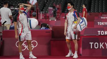 Foto: Angkat Koper dari Olimpiade Tokyo 2020, Pasangan Marcus/Kevin Dipaksa Tunduk oleh Pasangan Malaysia di Babak 16 Besar