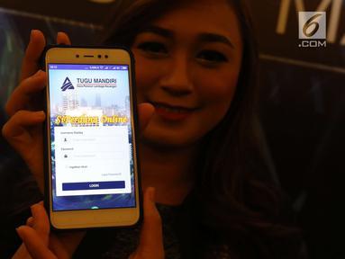 Model menunjukan aplikasi mobile SIPerdana usai di luncurkan di Jakarta, Rabu (28/3). Aplikasi ini merupakan sebagai satu-satunya system layanan informasi berbasis web di industry Dana Pensiun Indonesia. (Liputan6.com/Angga Yuniar)