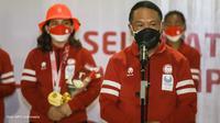 Menpora Zainudin Amali saat menyambut kedatangan kloter terakhir Kontingen Indonesia dari Paralimpiade Tokyo 2020. (Dok. NPC Indonesia)