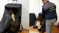 Salah satu perempuan Afghanistan yang bersembunyi di sebuah koper (CEN)