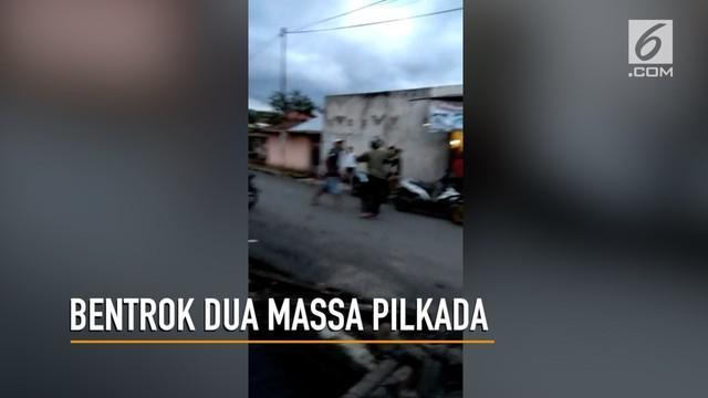 Bentrokan terjadi antara dua massa calon wali kota di Kotamobagu, Sulawesi Utara. Akibatnya dua orang jadi korban dan dilarikan ke rumah sakit.