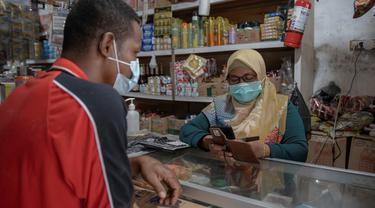 Platform Digital Grab Tingkatkan Literasi dan Inklusi Keuangan Hingga Ke Papua