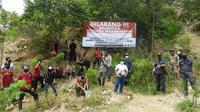 Aksi operasi simpatik aparat gabungan di kawasan PETI TN Lore Lindu di Dusun Dongi-dongi, Desa Sedoa, Poso saat peringatan Hari Bumi, 22 April lalu. (Foto: Balai Besar Taman Nasional Lore Lindu).