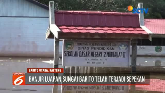 Memasuki hari ketujuh, banjir di enam kecamatan di Kabupaten Barito, Kalimantan Tengah masih tinggi.