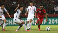 Todd Rivaldo Ferre beraksi saat Timnas Indonesia U-19 melawan Vietnam, Sabtu (7/7/2018) di Stadion Gelora Delta, Sidoarjo. (Bola.com/Aditya Wany)