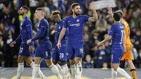 Striker Chelsea, Oliver Giroud, melakukan selebrasi usai membobol gawang PAOK Thessaloniki pada laga Liga Europa di Stadion Stamford Bridge, Kamis (29/11). Chelsea menang 4-0 atas PAOK Thessaloniki. (AP/Matt Dunham)