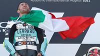 Pembalap Leopard Racing, Dennis Foggia, berhasil meraih podium juara dalam balapan Moto3 Italia di Sirkuit Mugello, Minggu (30/5/2021) sore WIB. (AP Photo/Antonio Calanni)