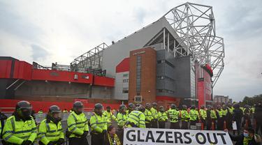 Aksi protes kembali mewarnai jalannya pertandingan Manchester United Vs Liverpool