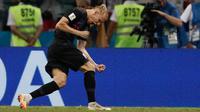 Domagoj Vida merayakan keberhasilannya membobol gawang Rusia pada laga perempat final Piala Dunia 2018. (AFP/Adrian Dennis)