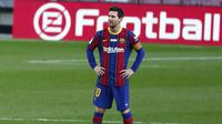 Bintang Barcelona Lionel Messi saat laga melawan Valencia pada lanjutan Liga Spanyol di Camp Nou, Sabtu (19/12/2020). (AP Photo/Joan Monfort)