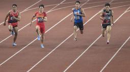 Pelari Indonesia, Lalu Muhammad Zohri, saat berlaga pada nomor 100 meter Asian Games di SUGBK, Jakarta, Minggu (26/8/2018). Lalu Zohri finish di urutan ke tujuh dengan catatan waktu 10,20 detik. (Bola.com/Vitalis Yogi Trisna)
