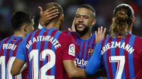 Memphis Depay. Striker anyar Barcelona ini langsung dimainkan dalam laga perdana melawan Real Sociedad dengan kemenangan 4-2. Ia tampil nyaris full-time usai digantikan pada menit ke-90. Aksinya membuahkan assist untuk gol pertama yang dicetak Gerard Pique. (Foto: AP/Joan Monfort)