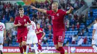 Striker muda Norwegia, Erling Haaland, melakukan selebrasi setelah mencetak gol ke gawang Gibraltar, Rabu (8/9/2021) dini hari WIB. Norwegia berhasil menang telak 5-1 dalam pertandingan tersebut. (Håkon Mosvold Larsen / NTB / AFP)