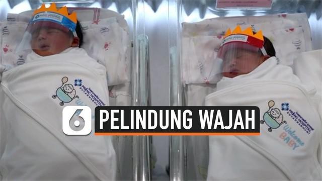 Antisipasi penularan virus corona diterapkan juga pada bayi-bayi di Thailand. Baru lahir, mereka langsung dipasang pelindung wajah.