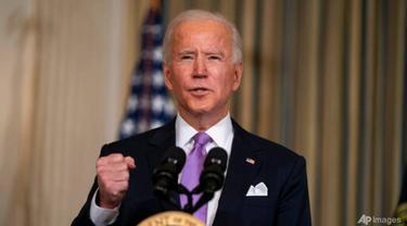 Presiden AS Joe Biden menyampaikan pidato tentang kesetaraan rasial di Ruang Makan Negara Gedung Putih pada 26 Januari 2021, di Washington.