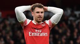 Aaron Ramsey menjelma menjadi pemain penting di skuat Arsene Wenger setelah didatangkan dari Cardiff City saat berusia 17 tahun. Ia tercatat telah mempersembahkan tiga gelar Piala FA untuk Arsenal. Sayangnya The Gunners harus melepasnya akibat sering terkena masalah cedera. (AFP/Ben Stansall)