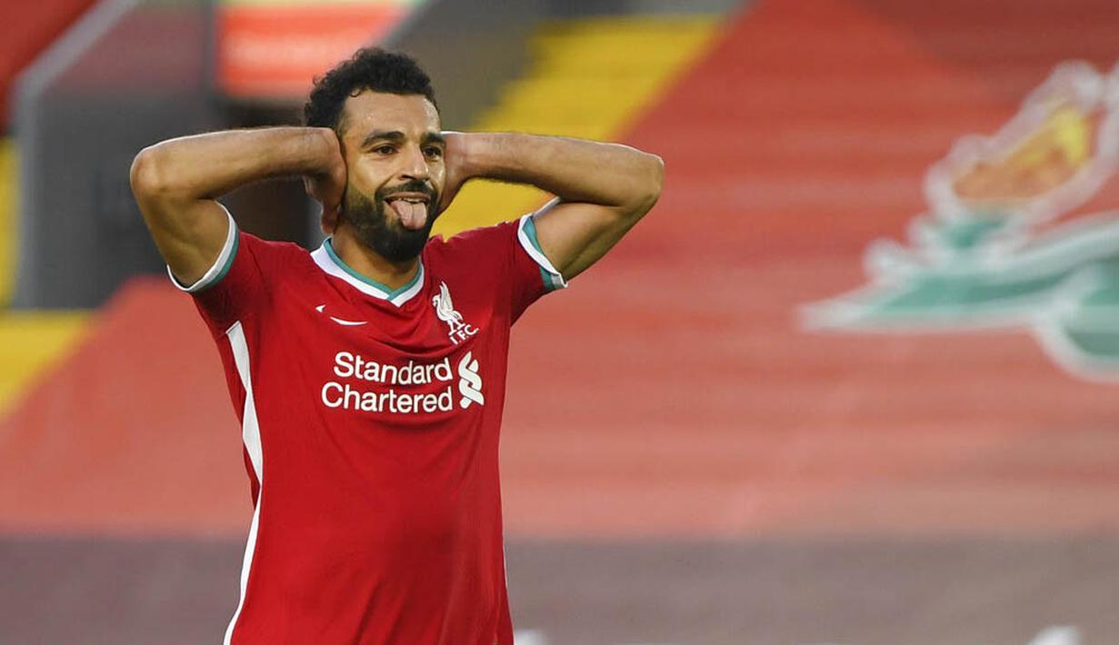 Penyerang Liverpool, Mohamed Salah, melakukan selebrasi usai mencetak gol ke gawang Leeds United pada laga Premier League di Stadion Anfield, Minggu (13/9/2020). Liverpool menang dengan skor 4-3. (Shaun Botterill, Pool via AP)