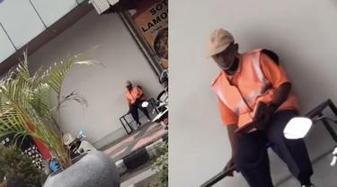 Viral Tukang Parkir Bertugas Sembari Membaca Al-Quran, Bikin Salut Warganet