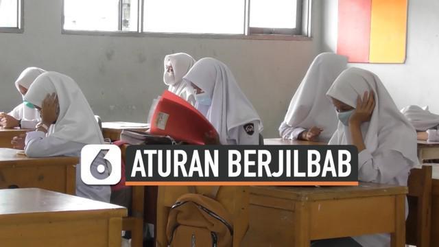 Aturan memakai jilbab untuk siswi non-muslim di SMKN 2 Padang Sumatera Barat jadi sorotan publik. Anggota DPRD Sumbar berharap persoalan ini segera selesai.