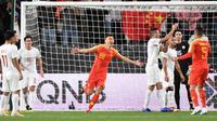 Timnas China menang 3-0 atas Filipina pada laga kedua Grup C Piala Asia 2019, di Mohammed bin Zayed Stadium, Abu Dhabi, Jumat (11/1/2019). (AFP/Khaled Desouki).
