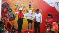 Pembalap Team Sapura Cycling, Jesse Ewart, berhasil mempertahankan yellow jersey hingga etape IV Tour de Singkarak 2018, Rabu (7/11/2018). (dok. Tour de Singkarak 2018)