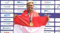 Atlet paralayang Indonesia, Jafro Megawanto  seusai upacara pemberian medali pada nomor ketepatan mendarat pria cabang Paralayang Asian Games 2018 di Gunung Mas, Puncak, Jawa Barat, Kamis (23/8). Jafro sukses meraih medali emas. (Merdeka.com/Arie Basuki)
