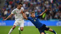 Sergio Busquets sedih Timnas Spanyol gagal ke final Euro 2020, namun bangga dengan perjuangan mati-matian saat melawan Timnas Italia. (AFP/Andy Rain)