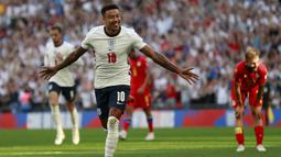 Pada menit ke-16 Inggris memimpin 1-0 berkat gol Jesse Lingard. Ia melepaskan sepakan mendatar ke pojok kiri gawang andorra yang gagal diantisipasi kiper Josep Gomes usai menerima umpan Bukayo Saka. (Foto: AP/Ian Walton)