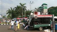 Demo sopir taksi online di depan Gedung DPR (Liputan6.com/ Linus Sandi Satya)