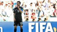 Ekspresi kekecewaan striker Timnas Argentina, Lionel Messi usai gagal mencetak gol lewat penalti ke gawang Timnas Islandia pada laga perdana Grup D Piala Dunia 2018. (Juan Mabromata / AFP)