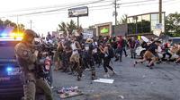 Aksi demonstrasi usai penembakan warga kulit hitam di Atlanta, Rayshard Brooks.  (Ben Gray/Atlanta Journal-Constitution via AP)