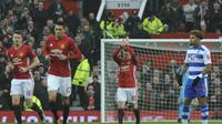 Selebrasi Wayne Rooney setelah mencetak gol pembuka Manchester United (MU) ke gawang Reading. (AP Photo/Rui Vieira)