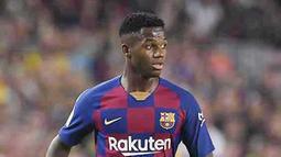 2. Pencetak Gol Termuda di Barcelona - Kali ini Ansu Fati masuk dalam buku rekor Barcelona sebagai pencetak gol termuda sepanjang sejarah klub. Jebolan La Masia itu sukses membobol gawang Osasuna saat berumur 16 tahun 304 hari. (AFP/Josep Lago)