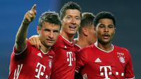 Pemain Bayern Munchen merayakan gol yang dicetak Serge Gnabry ke gawang Olympique Lyon pada semifinal Liga Champions 2019/2020 di Estadio Jose Alvalade, Kamis (20/8/2020) dini hari WIB. Bayern Munchen menang 3-0 atas Lyon. (AFP/Miguel A. Lopes/pool)