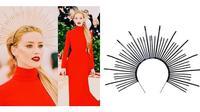 Saat ajang Met Gala kemarin, Amber Heard memakai Headpiece stunning yang terbuat dari kabel plastik.
