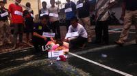 Rekonstruksi kasus pencabulan dan pembunuhan bocah Yuyun di Kabupaten Rejang Lebong, Bengkulu. (Liputan6.com/Yuliardi Hardjo Putra)